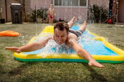 Build the ultimate, adult-sized Slip 'n Slide